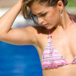Bikini woman by a swimming pool — Stock Photo