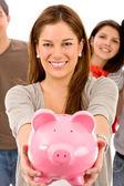 Woman saving money isolated on white — Stock Photo