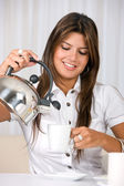 Casual woman pouring coffee — Stock Photo