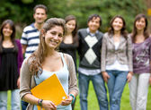 Casual students in the park — Stock Photo