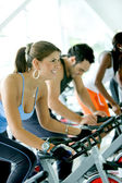 Spinning at the gym — 图库照片