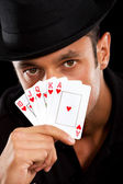 Magician with cards — Stock Photo
