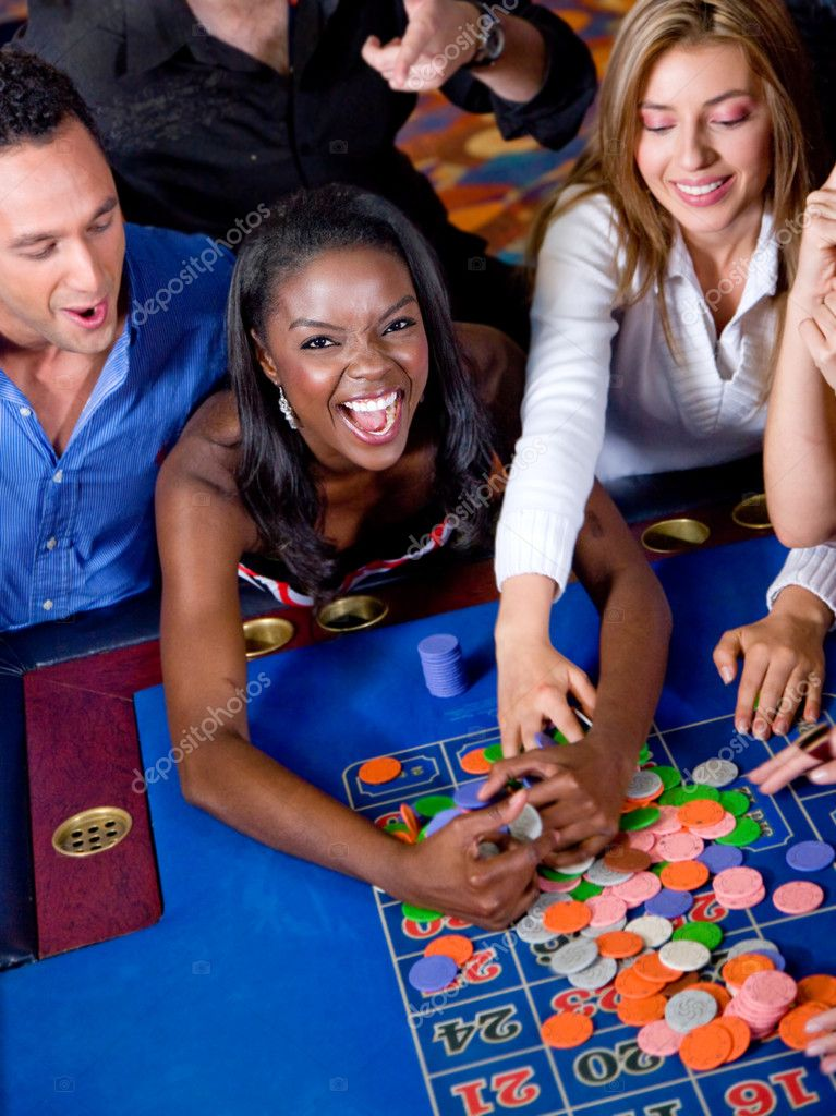 Group of on the casino roulette playing and winning — Stock Photo #7654174