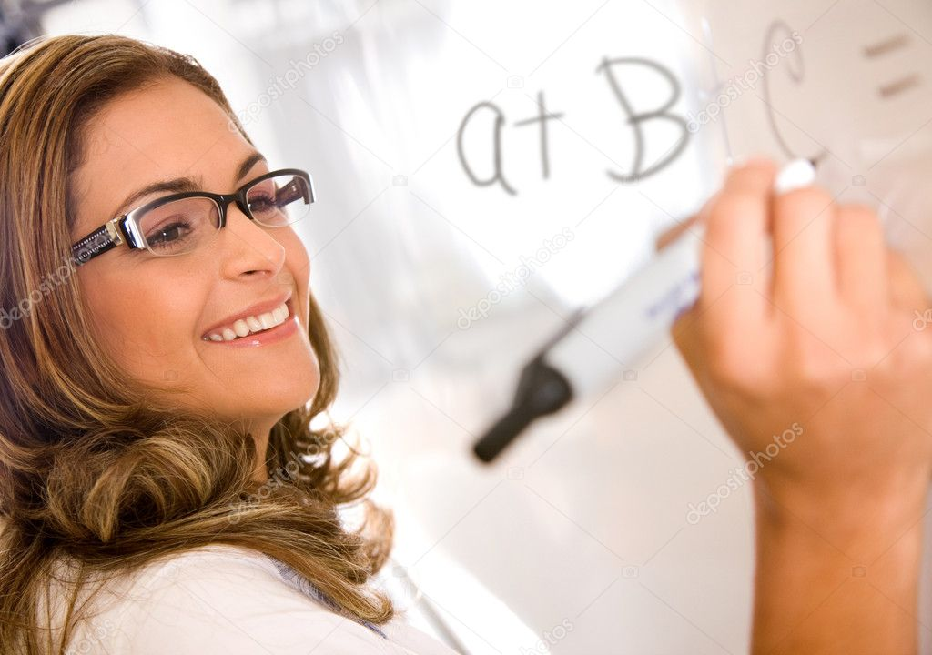 Casual teacher or student writing on a white board  Stock Photo #7654182