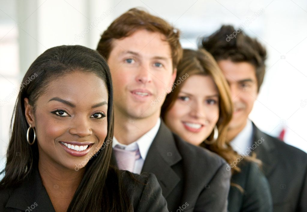 Group of business smiling in an office — Stock Photo #7654301