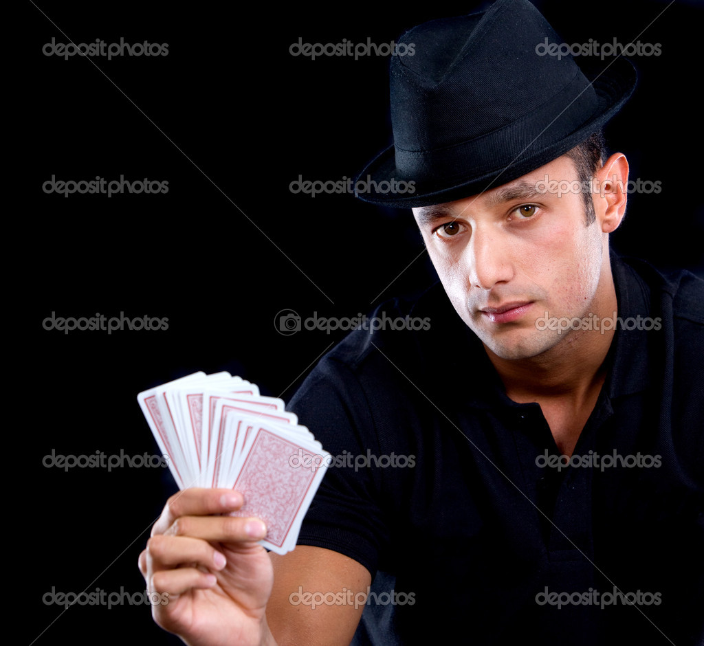 Male magician holding cards in his hand - isolated over black — Stock Photo #7654347