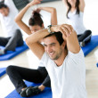 Gym group stretching — Stock Photo #7700448