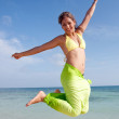 Girl jumping of joy — Stock Photo