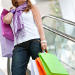 Shopping woman on scalators — Foto Stock