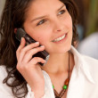 Businesswoman on her cell phone — Stock Photo