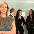 Business woman and her team — Stok fotoğraf