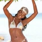 Black bikini woman smiling — Stock Photo