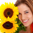Woman with sunflowers — Stock Photo