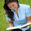 Stock Photo: Womstudying outside