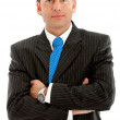 Arms crossed businessman - Stock Photo