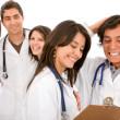 Very happy group of doctors — Stock Photo #7701875