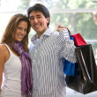 Stock Photo: Happy couple shopping