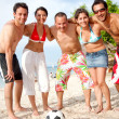 Football team at the beach - Stock Photo