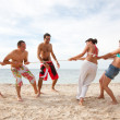 Beach friends pulling a rope — Stock Photo