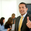Business man thumbs up - Stock Photo