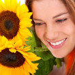 Royalty-Free Stock Photo: Woman with sunflowers
