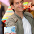 Shopping man with a bill — Stock Photo
