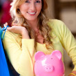Shopping woman saving money - Stock Photo