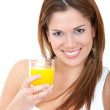 Woman having orange juice - Stock Photo
