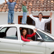 Family with a car - Stock Photo