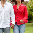 Couple running outdoors — Stock Photo
