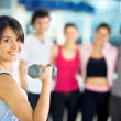 Woman lifting free weights — Stock Photo