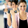 Stock Photo: Womwith free weights