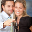 Business couple with keys — Stock Photo