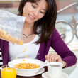 Royalty-Free Stock Photo: Woman eating her breakfast