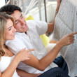 Stock Photo: Couple with newspaper