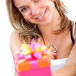 Girl with a gift — Stock Photo #7704203
