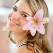 Beautiful woman with a flower — Stock Photo #7704214
