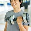 Man lifting free weights - Stock fotografie