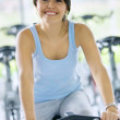 Woman doing spinning in a gym — Stock Photo