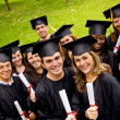 Happy graduates — Stock Photo