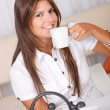 Casual woman drinking coffee — Stock Photo