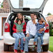 Family with a car — Stock Photo #7704576