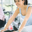 Womdoing spinning in gym — Stock Photo #7704634