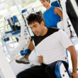 Man at the gym - weights — Stock Photo