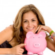 Woman with a piggy bank — Stock Photo #7704804