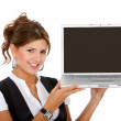 Business woman displaying a laptop — Stock Photo