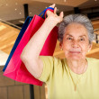 Beautiful senior doing some shopping — Stock Photo #7704912