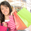 Royalty-Free Stock Photo: Beautiful girl with her shopping bags