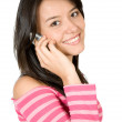 Girl talking on the phone in pink - Stock Photo