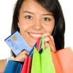 mooie tiener met shopping tassen — Stockfoto